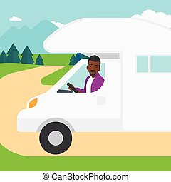 Man driving motor home - An african-american man driving a...