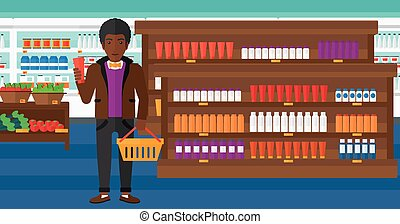 Customer with shopping basket and tube of cream - An...