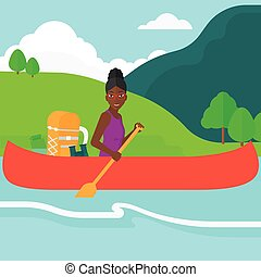 Woman canoeing on the river. - An african-american woman...