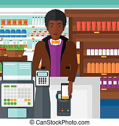 Customer paying with his smartphone using terminal - An...