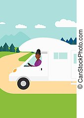 Woman driving motor home - An african-american woman driving...