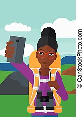 Backpckaer making selfie. - An african-american woman making...
