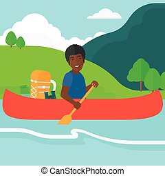 Man canoeing on the river. - An african-american man...