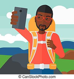 Backpckaer making selfie. - An african-american man making...