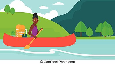 Woman canoeing on the river - An african-american woman...