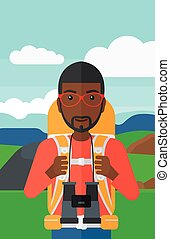 Cheerful backpacker with binoculars. - An african-american...