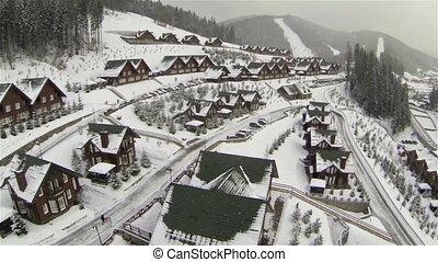 Aerial shot of houses on the hill in winter