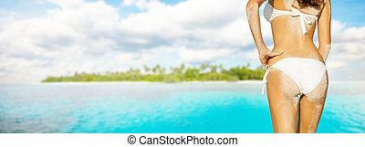 Young woman in bikini looking at island - Young woman in...