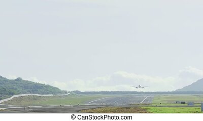 Airbus 320 approaching and landing at Phuket airport -...