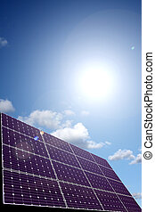 Solar energy panel with sky and sun in background