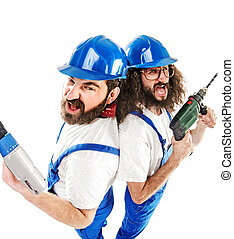 Conceptual picture of two builders while working -...