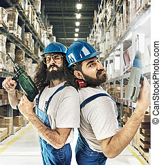 Portrait of two builders in a storehouse