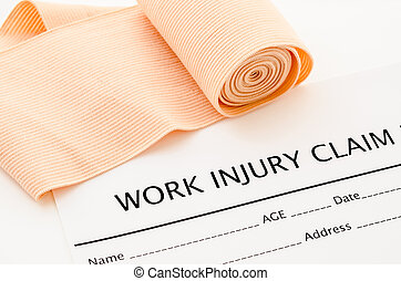 Work injury claim form showing business insurance concept. -...