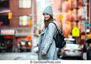 woman walking on city