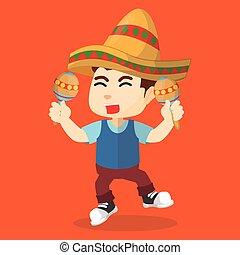 Boy playing maracas
