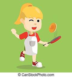 Girl cooking pancake