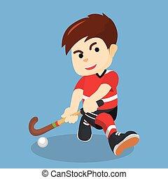 Boy playing hockey
