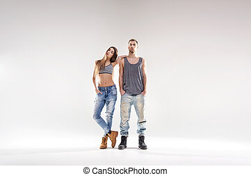 Sporty hip-hop couple isolated over the white background
