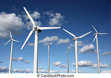 Wind power farm with sky and clouds in the background