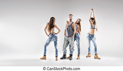Handsome dancer with pretty ladies