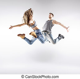 Talented hip-hop dancers practising together - Talented...