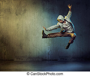 Athletic dancer in a jumping pose - Athletic dancer in a...