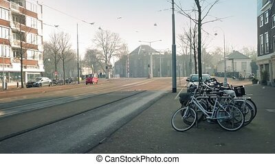 Bikes Passing In European City - Cyclists pass on road in...