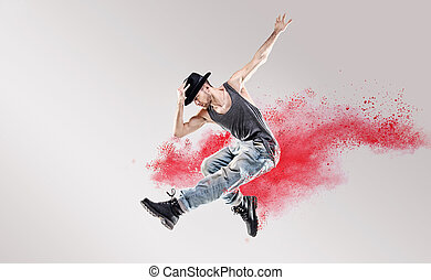 Conceptual picture of hip hop dancer among red dust -...