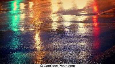 Cars On Wet Road Shining Colors - Closeup of wet road with...