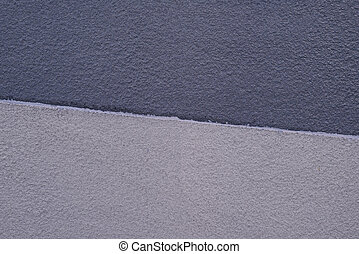 Concrete wall texture two tones design, gray and cream colors.