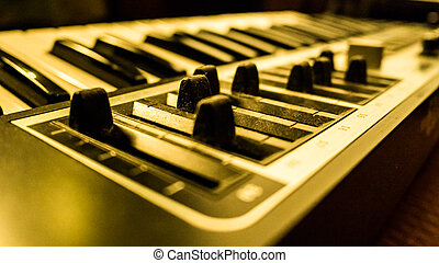 digital musical piano synthesizer - Macro view of black...
