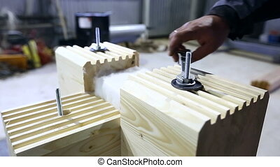 View of worker tightens fasteners with wrench - Woodworking....