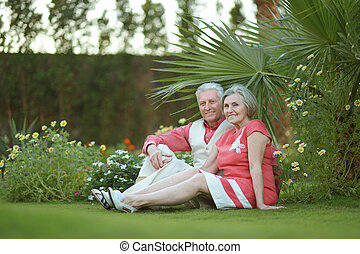 Loving elder couple - Loving elder couple sitting on a...