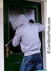 burglar at a house door