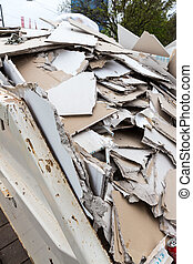rubble plasterboard in container - in a dumpster store...