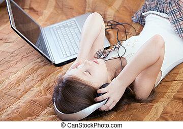 Cute kid listening to music on headphones