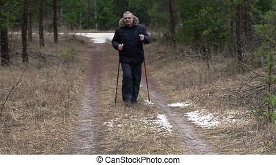 Hiker walking on forest path
