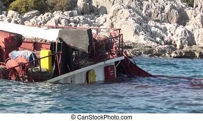 Sunk ship zoom out - Sunken ship near the cliffy seacoast, a...