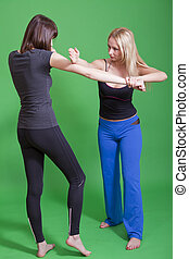 woman self defence - women self defence classes on green...