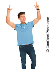 man celebrating with both hands raised