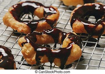 Doughnut - Classic chocolate doughnut on the table