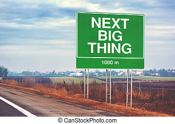 Next big thing ahead conceptual image with road sign