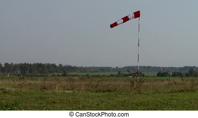 View of windsock at airfield in summer time
