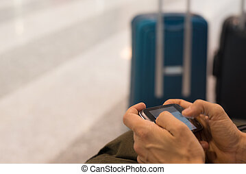 Smart phone with internet wireless connection in airport...