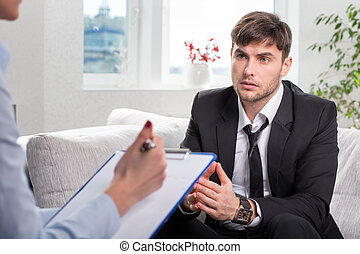 Depressed businesman talking with psychologist - Depressed...