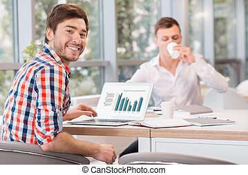 Cheerful men sitting at the table - Get some rest Cheerful...