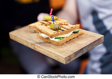 Fresh and tasty sandwich with ham and vegetables on wooden...