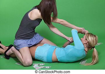 two women fighting - two young women fighting on the ground...