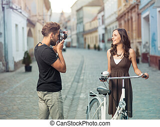 posing a beautiful gril - Young photographer stops a...
