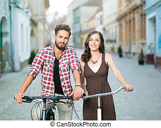 friends on bicycles smiling